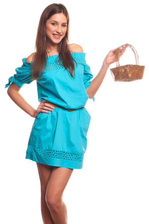 skintight: Pretty girl in blue dress with basket isolate on white background Stock Photo
