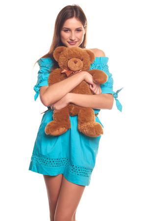 Pretty girl in blue dress with teddy bear isolate on white background