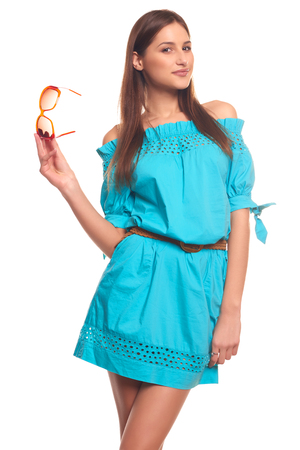 Pretty girl in blue dress with glasses isolate on white background