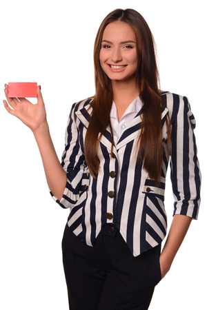 ides: Beautiful office girl showing card isolated on a white background