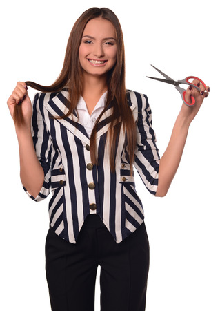 ides: Beautiful office girl showing scissors isolated on a white background