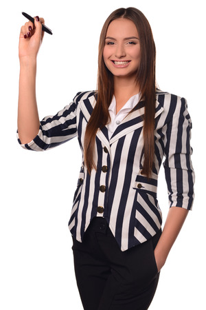 ides: Beautiful office girl showing pen isolated on a white background