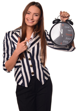 ides: Beautiful office girl showing clock isolated on a white background