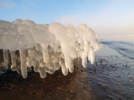 Beautiful Ice stalactites on the lake shore Stock Photo - 8462574