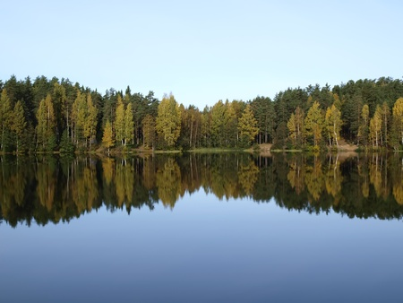Calm, deep forest lake. Autumn season         Stock Photo
