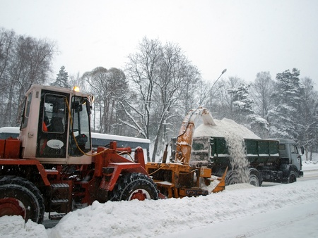 SAINT-PETERSBURG, RUSSIA- DECEMBER 12: Snow removal machines with an unidentified driver clean snow-covered road after cyclone called Monica on December 12, 2010 in Saint-Petersburg, Russia   Stock Photo - 11229484