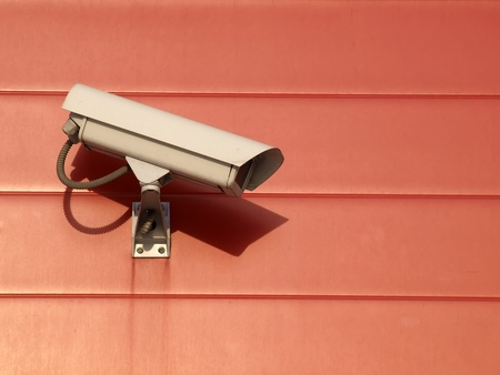 Security camera on the red wall  Stock Photo