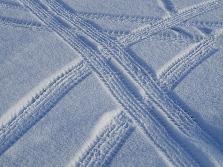 Car tracks on the snow         photo