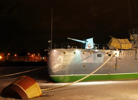 Famous cruiser Aurora at night. Cruiser is a symbol of the revolution in Russia in 1917