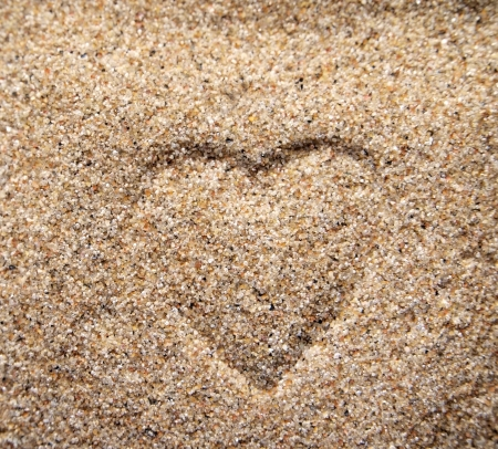 evoke: Heart on the sand      Stock Photo