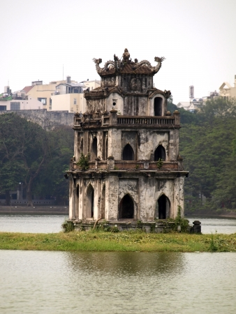 long lake: Tortoise Tower is the symbol of Hanoi,Vietnam         Stock Photo