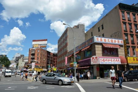 enclave: NEW YORK CITY - AUGUST 08  Chinatown district in NYC on August 08, 2013  It is the largest and oldest such enclave in the Western Hemisphere with nearly 100,000 residents Editorial