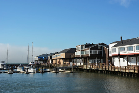 warren: SAN FRANCISCO, USA - AUGUST 17  Pier 39 at San Francisco Bay, on August 17, 2013  Pier 39 was first developed by entrepreneur Warren Simmons and opened October 4, 1978 Editorial