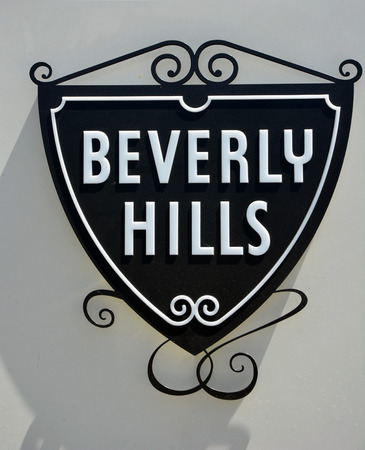 BEVERLY HILLS, CA - AUG 21  Beverly Hills sign, Ca on Aug  21, 2013  Beverly Hills is world-famous for its luxurious culture and famous residents