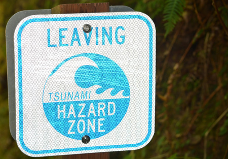 Sign on the Pacific ocean shore