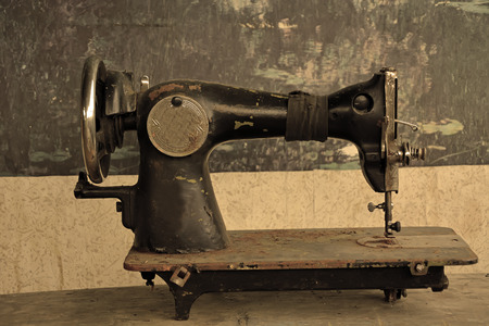 Abandoned stitching machine photo