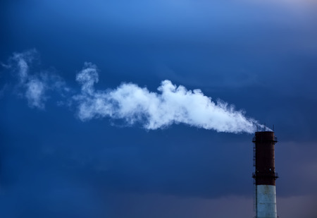 moody: Industry pollution with moody sky background