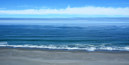 Pacific ocean from the top with blue sky background photo