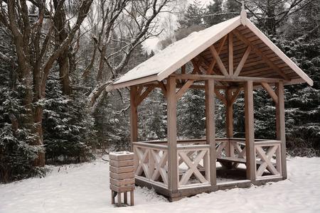 summerhouse: Wooden summerhouse at the winter season. Sepia toned