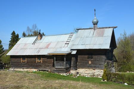 Old wooden church in Staraya Ladoga town photo