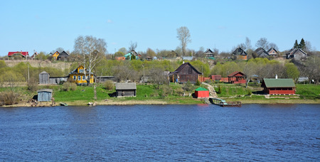 volkhov: Volkhov river panorama with houses at the shore. Staraya Ladoga village