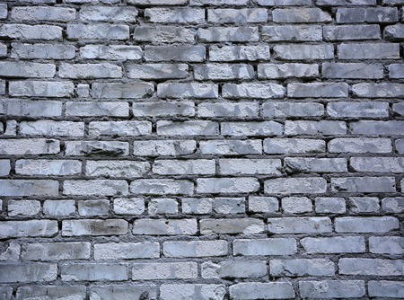 split level: Grey brick wall. Picture can be used as a background Stock Photo