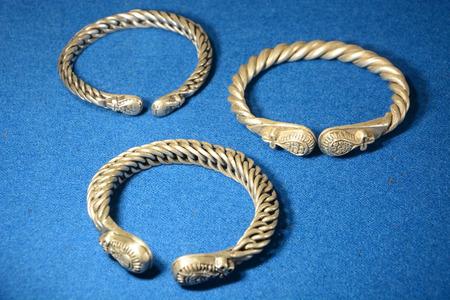 VELIKY NOVGOROD, RUSSIA - FEBRUARY 22, 2015: Ancient russian bracelet on the fabric on February 11, 2015 in Veliky Novgorod
