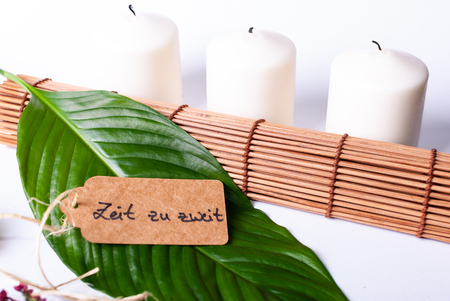 A set up of wellness items, a bamboo mat, a shell, candles, a branch, wood, a starfish Stock Photo