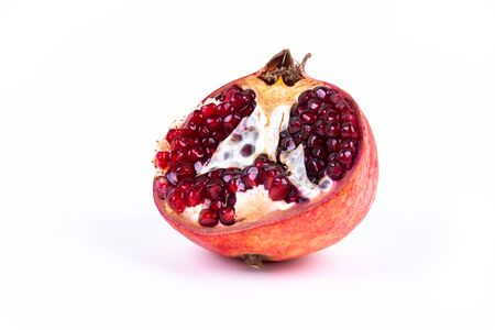 Half a pomegranate on white background with copy space - angled view