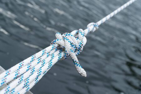 Close up of a knot in a rope of a sailing boat
