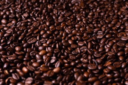 Close up of fresh roasted brown coffee beans - angled view