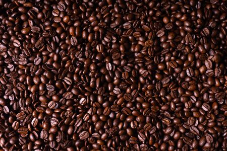 Close up of fresh roasted brown coffee beans