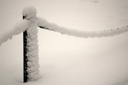 guardrail: guardrail covered by snow, horizontally framed shot