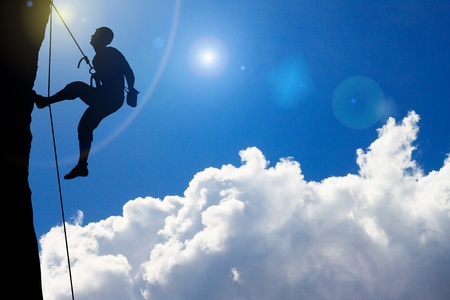 descending: rock Climbing on  beautiful cloud sky