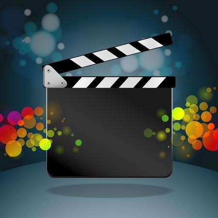 Clapper board in dark background photo