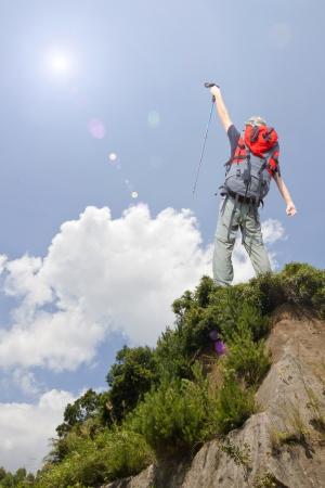 alpinism: rock Climbing on  beautiful cloud sky