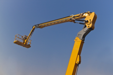 The Arm and Platform of Yellow Picker,Articulating Boom Lift photo