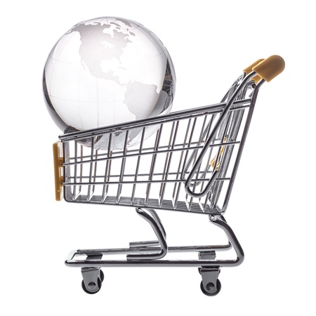 isolated shopping cart and globe on the white photo