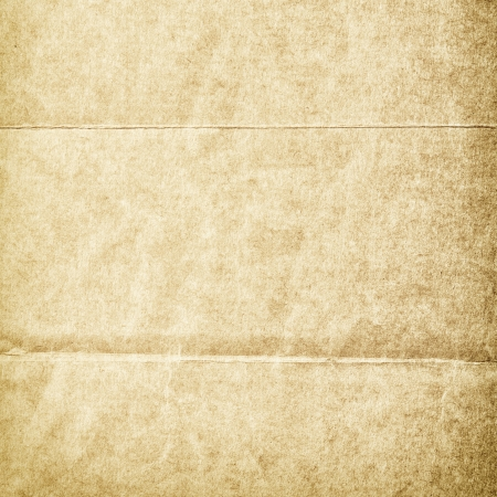 beige backgrounds: Folded grungy stained old paper