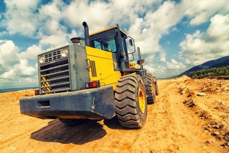 building site: Bulldozer at Construction Site Stock Photo