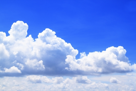 theatricality: White cloudy shining brightly sky with blue space for text or image