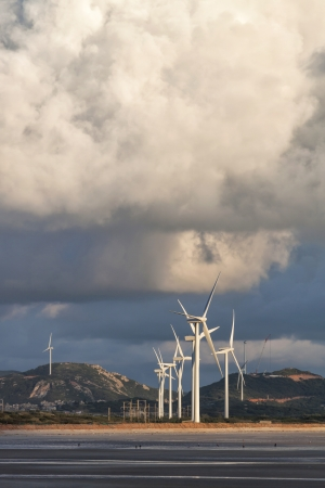 Group of wind power installations in sunrise Stock Photo - 15232889