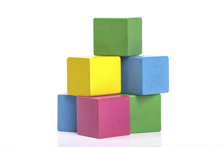 Colorful wooden building blocks isolated on white background photo