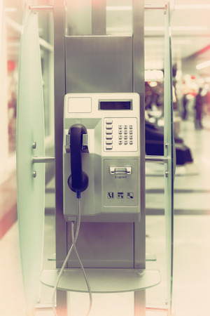 Public phone in airport hall photo