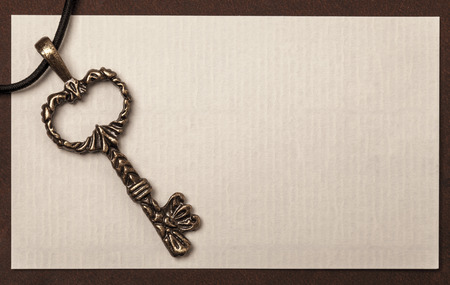 Vintage key and paper texture background with space for your text or image photo