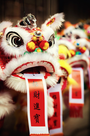 chinese new year decoration: Traditional colorful chinese lion, Chinese paper means: good fortune. Stock Photo