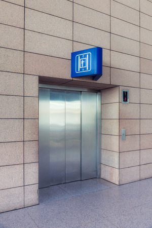 lift gate: Modern elevator with closed doors