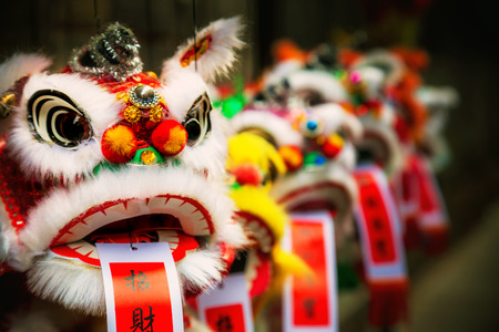 chinatown: Traditional colorful chinese lion, Chinese paper means: good fortune. Stock Photo