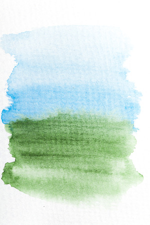 Blue and green gradient watercolor brush strokes on white rough texture paper with space for your texts and images photo