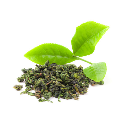 plant antioxidants: Heap of dry tea with fresh green tea leaves isolated white background. real Chinese tea bushes